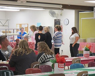 Neighbors | Alexis Bartolomucci.Guests lined up to get their pasta at Poland Seminary High School during the pasta dinner event on Oct. 2 for the PSHS band.
