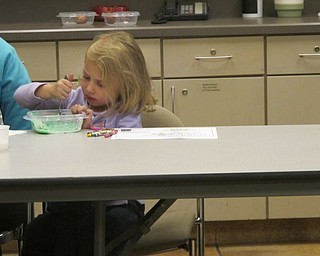 Neighbors | Alexis Bartolomucci.Ava mixed her mashed potatoes with food coloring to make her mashed potatoes green during Sprout Club at Fellows Riverside Gardens on Oct. 13.