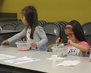 Neighbors | Alexis Bartolomucci.Gabby and Ana mix together their mashed potatoes with food coloring to make different colored mashed potatoes during Sprout Club on Oct. 13 at Fellows Riverside Gardens.