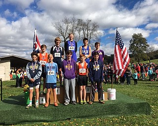 Neighbors | Submitted.Mason Matiste posed on the first place podium after beating out all 568 runners in the championship meet.