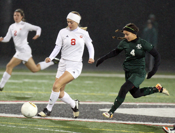 William D. Lewis the Vindicator  Mooney's Colleen Durkin(8) and Ursuline's Adi Quattro(4) go for the ball during 10272016 action at Girard.
