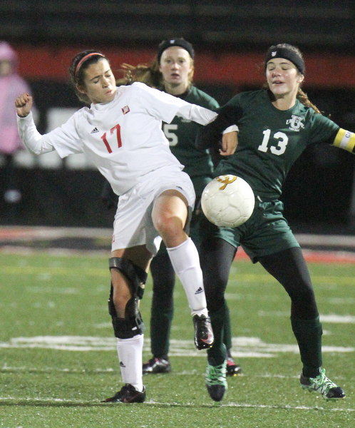 William D. Lewis the Vindicator  Mooney's Elizabeth Philibin(17 and /ursulines Abby Price (5) and ) and Ursuline's Breanna Bowell(13) go for the ball during 10272016 action at Girard.