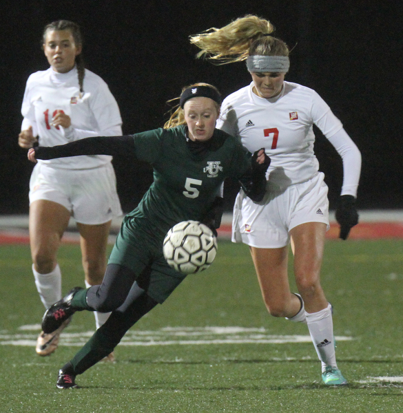 William D. Lewis the Vindicator  Ursuline's Abby Price(5) and Mooney's Alexa Saunders(7) go for the ball during 10272016 action at Girard.