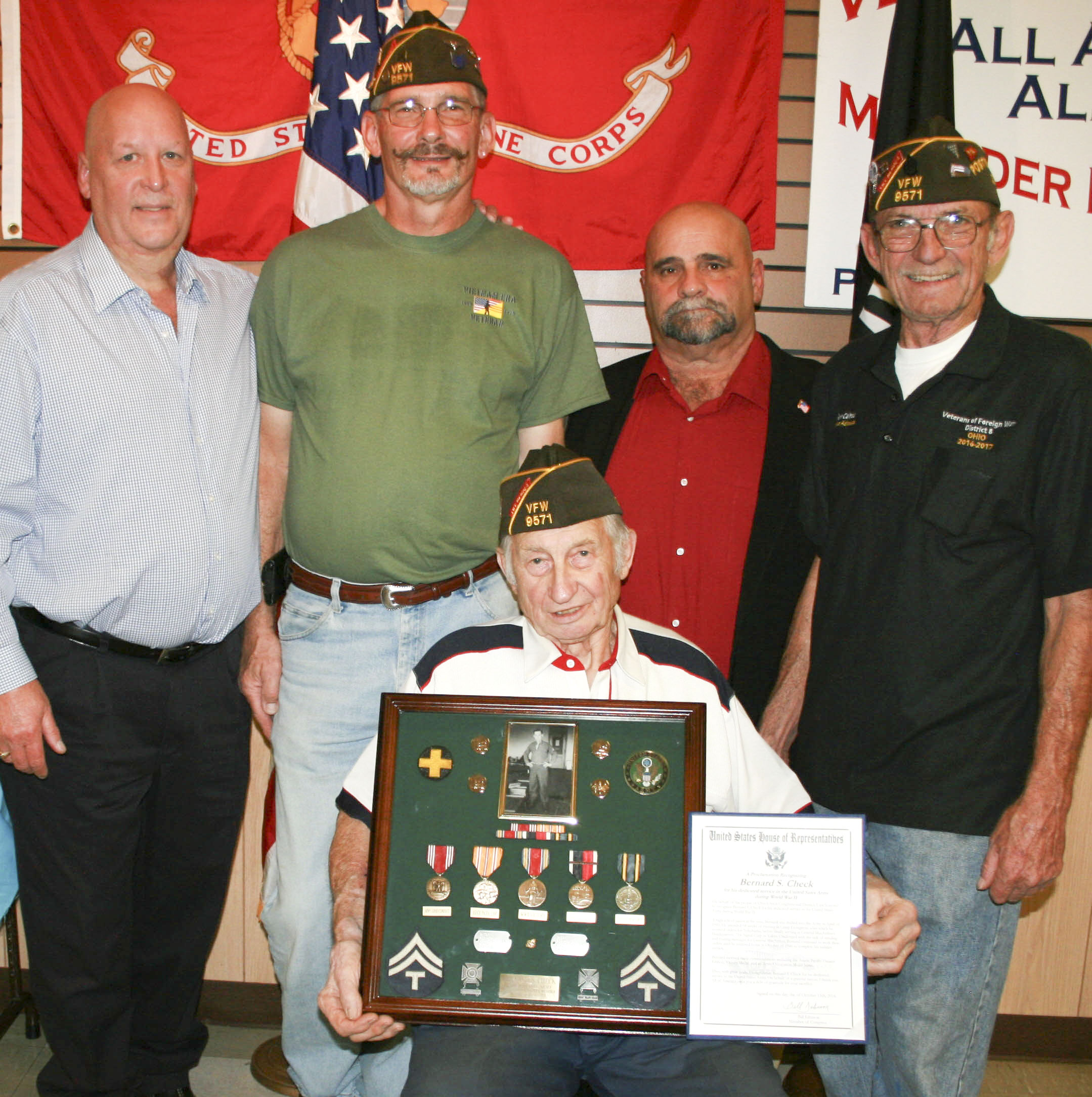 SPECIAL TO THE VINDICATOR: Veterans of Foreign Wars Post 9571 in Ellsworth recently honored Bernard S. Check with a Congressional Proclamation of Recognition for his service in the Army during World War II. Check was drafted in 1945 as a junior in high school and eventually served at General MacArthur's headquarters in Tokyo. Some of the awards he received included the Asiatic Pacific Theater ribbon, Victory medal, and an Army Occupation Medal, Japan. Check, seated, received the award from Denny Furman, Berlin Center Township trustee, standing on the left; Tom Check, vice post commander; Artie Spellman, Ellsworth Township trustee; and Ken Calhoun, post commander.