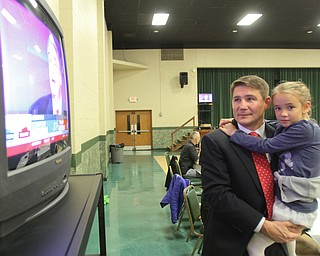 William D. Lewis The Vindicator John Boccieri and his daughter Emma, 6,during an election night party at St Luke Hall in Boardman.