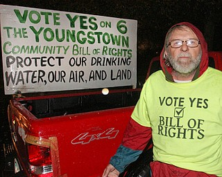 William D. Lewis The Vindicator Randy Younkin, Community Bill of Rights supporter, stands with a sign in his pick up truck outside Box Car Lounge where other Community bill of Rights supporters gathered Tuesday Nov. 8, 2016 after the election.