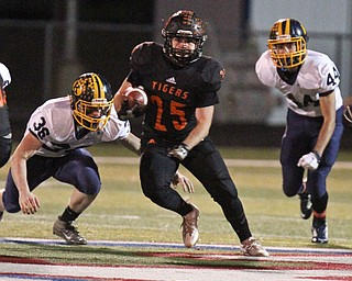 William D. Lewis/The Vindicator  Springfield's Luke snyder(25) eludes Kirtland's John Miller(36)Jeremy Davis(44)during Nov 11, 2016 playoff game with Kirtland at Austintown.