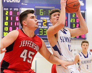 William D. Lewis the vindicator  Poland's Brandon Barringer(13) shoots around Jefferson'sSam Chaney(45) to score during Feb 13, 2017 action at Poland.