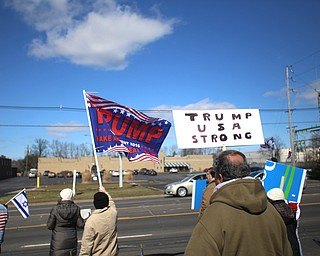 Supporters of President Donald Trump hold flags and signs at the Summitville Tile parking lot on 224, Saturday, March 4, 2017 in Boardman. ..(Nikos Frazier | The Vindicator)..