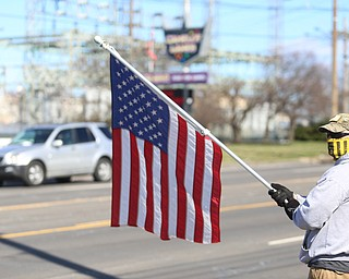 Josh Kellar of Girard holds an American Flag as he and others show their support for President Donald Trump at the Summitville Tile parking lot on 224, Saturday, March 4, 2017 in Boardman. ..(Nikos Frazier | The Vindicator)..