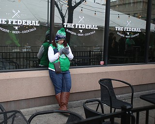 Lindsey Bisconti of Cuyahoga Falls waits outside of The Federal during Sham-Rock on the Block, Friday, March 17, 2017, in downtown Youngstown. ..(Nikos Frazier | The Vindicator)..
