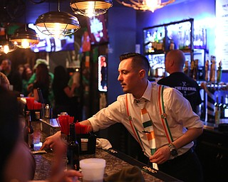 Eric Darino, a bartender at The Federal serves drinks during Sham-Rock on the Block, Friday, March 17, 2017, in downtown Youngstown. ..(Nikos Frazier | The Vindicator)..