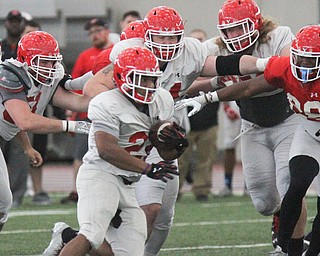 William D. Lewis The Vindicator YSU (22) carries the ball during 4-7-17 practice.