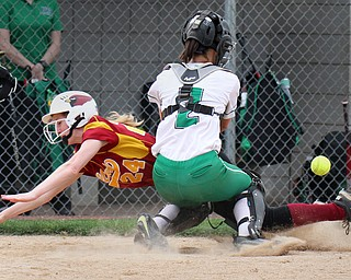William D. Lewis The Vindicator  Mooney's Kelly Williams(24) is safe as WB catcher Bailey Byers(2) looses the ball at the plate during 4-19-17 action at Fields of Dreams.