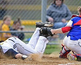 BERLIN CENTER, OHIO - APRIL 19, 2017: McDonald's Zach Nolf, left, face plants while reaching for home plate after being tagged out by Western Reserve's Dylan Smith in the second inning of Wednesday evenings game at Western Reserve High School. DAVID DERMER | THE VINDICATOR