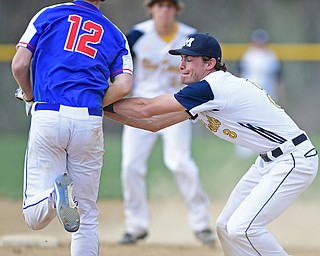 BERLIN CENTER, OHIO - APRIL 19, 2017: McDonald's Dylan Portolese, right, tags out Western Reserve's Caleb Quinn before throwing it to first to turn a double play in the second inning of Wednesday evenings game at Western Reserve High School. DAVID DERMER | THE VINDICATOR