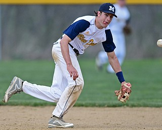 BERLIN CENTER, OHIO - APRIL 19, 2017: McDonald's Dylan Portolese attempts to chase down the ball before it bounces into center field in the fifth inning of Wednesday evenings game at Western Reserve High School. DAVID DERMER | THE VINDICATOR
