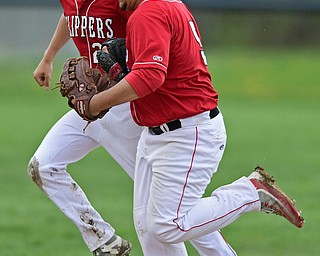 COLUMBIANA, OHIO - APRIL 20, 2017: Columbiana's Vince Vivo, left, and Tim Davin, right, celebrate after Vivo caught the ball to end the fourth inning of Thursday evenings game at Firestone Park. Columbiana won 4-2. DAVID DERMER   THE VINDICATOR