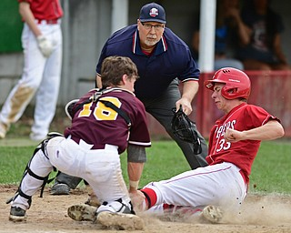 COLUMBIANA, OHIO - APRIL 20, 2017: Columbiana's A.J. Perkins, right, is tagged out at home by South Range's M.J. Lucas preventing a run in the fifth inning of Thursday evenings game at Firestone Park. Columbiana won 4-2. DAVID DERMER   THE VINDICATOR