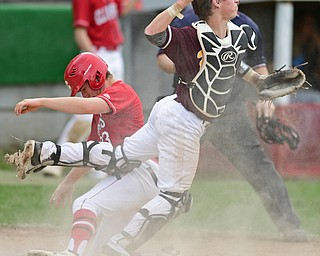 COLUMBIANA, OHIO - APRIL 20, 2017: South Range's M.J. Lucas, right, was an off balance throw to third base after tagging out Columbiana's A.J. Perkins at home in the fifth inning of Thursday evenings game at Firestone Park. Columbiana won 4-2. DAVID DERMER   THE VINDICATOR