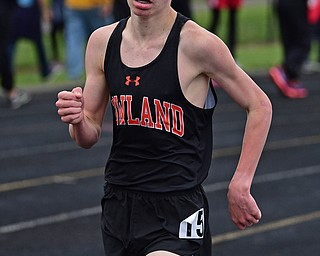 POLAND, OHIO - APRIL 29, 2017: Howland's Vincent Mauri sprints to the finish line on the last lap of the boys 3200 meter run, Saturday morning during the Poland Invitational at Poland High School. DAVID DERMER | THE VINDICATOR