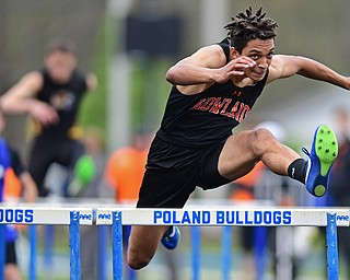 POLAND, OHIO - APRIL 29, 2017: Howland's Jacob Williams clears a hurdle during his heat of the boys 110 meter hurdles, Saturday morning during the Poland Invitational at Poland High School. DAVID DERMER | THE VINDICATOR
