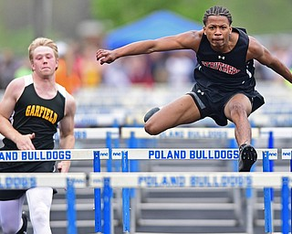 POLAND, OHIO - APRIL 29, 2017: Struthers Kylel Griffin clears a hurdle ahead of Garfield's Chris Blewitt during their heat of the boys 110 meter hurdles, Saturday morning during the Poland Invitational at Poland High School. DAVID DERMER | THE VINDICATOR