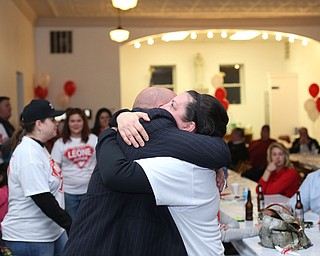 Catherine Miller hugs Dominic Leone III as he is declared the winner at the St. Anthony's Hall, Tuesday, May 2, 2017 in Struthers.   (Nikos Frazier | The Vindicator)