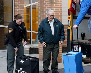 Joe Aless(center left) hands off his ballot boxes to Board of Election Officials at St. Christine Parish Center, Tuesday, May 2, 2017 in Youngstown. ..(Nikos Frazier | The Vindicator)..Offcials: Deputy Stephanie Harchar, Nick Sharpe(blue).
