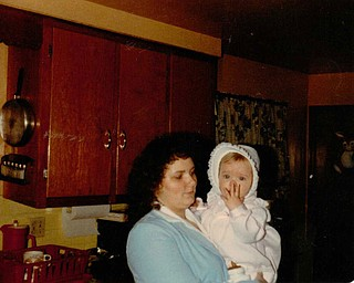 Peggy Brewer of Girard, holds her daughter, Lisa Kuty, also of Girard, as a toddler.