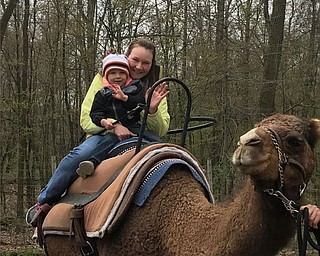 Michelle and Hunter Martin of Poland take a camel ride.