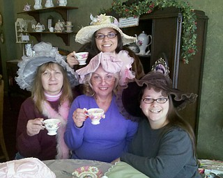 Enjoying a special time at Piccadilly Parlour Victorian Tea Room in Canfield were Julie Cancio Harper of Boardman, in back, and, from left, her aunt, Judy Urban of Lordstown; mom Janet Scialabba of Boardman; and sister Jannifer Cancio, also of Boardman.