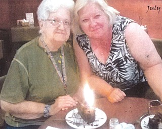 Grace Leash and her daughter, Carol Troll, both of Girard, enjoy a special dessert together.