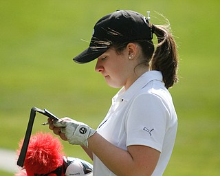 ROBERT K. YOSAY  | THE VINDICATOR..Greatest Golfer Junior at Squaw Creek Sat May 13..looking over her score card as they make the break between 9 and 10  Gillian Cerimele
