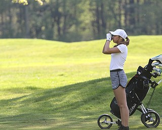 ROBERT K. YOSAY  | THE VINDICATOR..Greatest Golfer Junior at Squaw Creek Sat May 13..checking the length  from her fairway shot on 10 to the green is Emily Marcavish