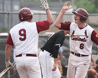 William D. Lewis The Vindicator Mooney's Brennen Olesh(9) and Jake Fonderlin(6) hi 5 after scoring during 5-17-17 game with Mooney at Cene. Crestview won 10-3.