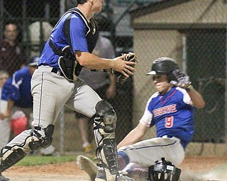 William D. Lewis The Vindicator Western Reserve's Wyatt Larimer(9) scores winning run in 11 inning game with Jackson Milton at Cene 5-19-17
