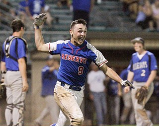 William D. Lewis The Vindicator Western Reserve's Wyatt Larimer(9) reacts after scoring winning run in 11 inning game with Jackson Milton at Cene 5-19-17