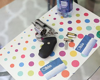 A revolver was found along with Ohio Direction cards and drugs as Youngstown Police search a house on the 200 block of E Judson Ave, Thursday, June 1, 2017 in Youngstown...(Nikos Frazier | The Vindicator)