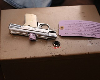 A revolver found in the basement is tagged as evidence as Youngstown Police search a house on the 200 block of E Judson Ave, Thursday, June 1, 2017 in Youngstown...(Nikos Frazier | The Vindicator)