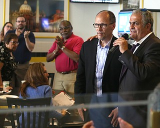 David Betras(right), Chairman of the Mahoning County Democratic Party and Democratic National Committee (DNC) chairman Tom Perez speaks at Wedgewood Pizza, Friday, June 9, 2017 in Boardman. Perez visited Ohio two days after President Donald Trump spoke in Cincinnati, which Perez stopped in on Thursday...(Nikos Frazier | The Vindicator)
