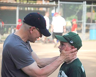 Keith Carpenter, seen with youngest son Evan, is in the U.S. army Reserve and spends his free time coaching.