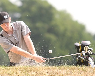 Keegan Butler(U-17) chips the ball out of a sand trap on hole 7 during the Greatest Golfer of the Valley Junior Qualifier at Tam O'Shanter Golf Course, Thursday, June 15, 2017 in Hermitage...(Nikos Frazier | The Vindicator)