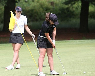 Gillian Cerimele(U-17) chips the ball onto the green on hole 11 while Jenna Vivo holds the flag during the Greatest Golfer of the Valley Junior Qualifier at Tam O'Shanter Golf Course, Thursday, June 15, 2017 in Hermitage...(Nikos Frazier | The Vindicator)