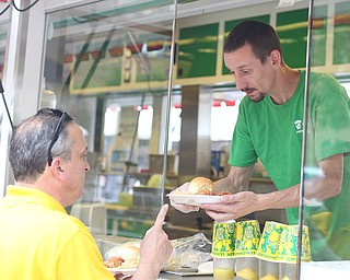 Chris Starkey of The Original Jam Concessions, serves Bill Harris of Boardman plates of Haluski during the Simply Slavic Festival at Federal Plaza East, Saturday, June 17, 2017 in downtown Youngstown...(Nikos Frazier | The Vindicator)