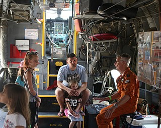 Jack McMahon, a C-123K pilot, talks with Jason Welling(center) and daughters; Haiden(10), Charolotte(6), Adaliah(12) and Makenna(8) of Middlefield during the Thunder Over the Valley Air Show at the Youngstown Air Reserve Station, Saturday, June 17, 2017 in Vienna...(Nikos Frazier | The Vindicator)