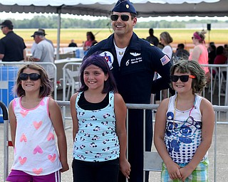 (From left) Amanda Summerfield(8), Gabrielle Beem(9) and Marlee Summerfield(8) pose for photos with Maj. Whit Collins(#6) during the Thunder Over the Valley Air Show at the Youngstown Air Reserve Station, Saturday, June 17, 2017 in Vienna...(Nikos Frazier | The Vindicator)