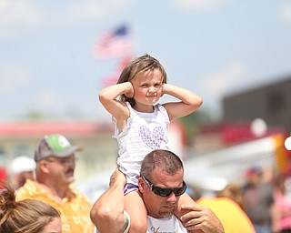 Layla Dillinger(4) of Girard covers her ears as she sits on her dad, Keith's shoulders during the U.S. Air Force Thunderbirds demonstration team performs during the Thunder Over the Valley Air Show at the Youngstown Air Reserve Station, Saturday, June 17, 2017 in Vienna...(Nikos Frazier | The Vindicator)