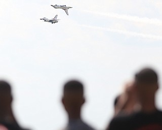 The U.S. Air Force Thunderbirds demonstration team performs during the Thunder Over the Valley Air Show at the Youngstown Air Reserve Station, Saturday, June 17, 2017 in Vienna...(Nikos Frazier | The Vindicator)