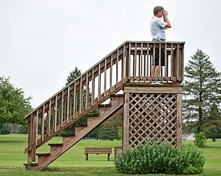 SALEM, OHIO - JULY 6, 2017: Carl DeSiato of Canfield uses his range finder atop a tower allowing him to see the green of the 12th hole during the Vindy Greatest Golfer qualifying round at Salem Hills Golf Course, Thursday afternoon. DAVID DERMER | THE VINDICATOR